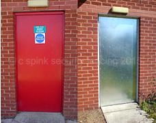 Steel sheet cladding to external access door