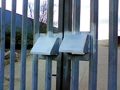 Padlock cover hoods fitted to existing entrance gates