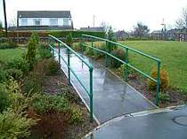 Green powder coated hand rails formed from powder coated galvanised steel tube and tubular clamp connectors
