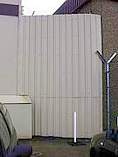 Fence constructed from coated steel sheet cladding