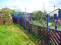 Blue powder coated V-Beam mesh panel fencing - mesh panels supported on 60x60mm square tube fence posts