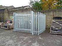 Galvanised palisade fence compound with a single leaf full width access gate