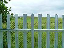 Galvanised rounded top D profile fence pales