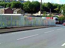 Galvanised steel palisade fencing with triple pointed tops
