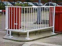 Pedestrian railings located between automatic barrier units